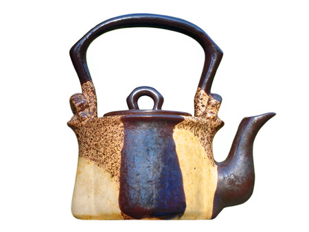 loamy: Ceramic teapot isolated on white background.