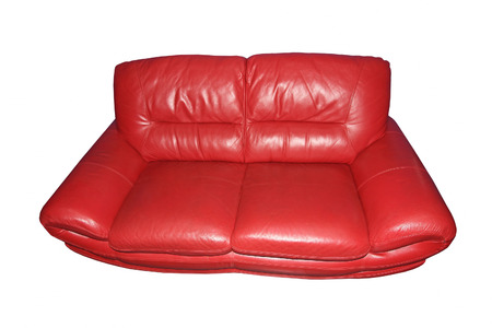 red sofa: Red leather sofa isolated on white background. Stock Photo