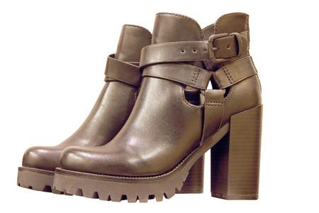 Black leather high-heeled womanish boots isolated on white background. photo