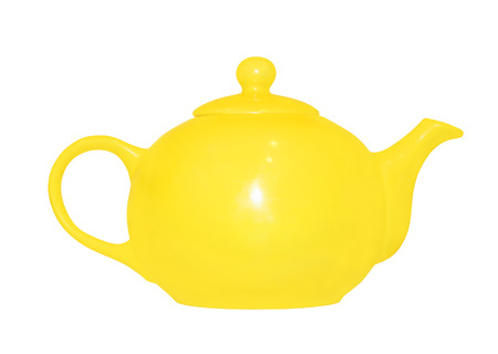 loamy: Yellow ceramic teapot isolated on white background.