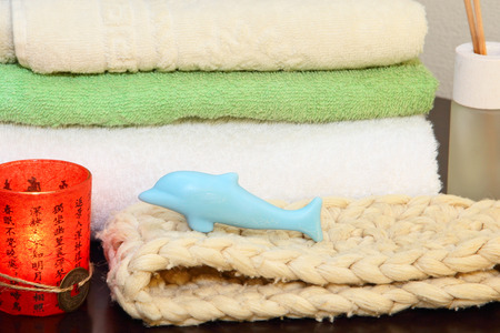 terrycloth: Towel stack, bast and soap in the form of a dolphin.