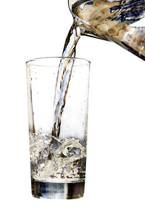 Water jug pouring to glass on white background.Digitally generated image. photo