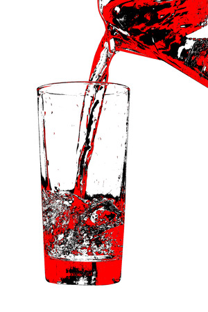 Jug pouring red liquid to glass on white background.Digitally generated image. photo