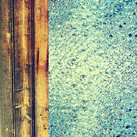 azure: Toned azure drips and wooden timber as abstract background.Digitally generated image.