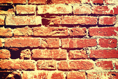taken: Red old grunge brick wall taken closeup as abstract background.Toned image. Stock Photo