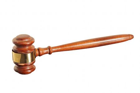 legislator: Wooden judge gavel taken closeup isolated on white background.