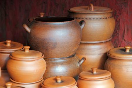 loamy: Lot of ceramics pots for sale taken closeup.