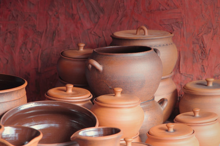 loamy: Different kinds of ceramics pots for sale taken closeup.