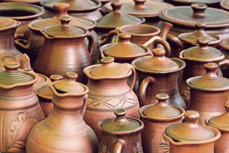 loamy: Lot of ceramics pots for sale taken closeup.Toned image. Stock Photo