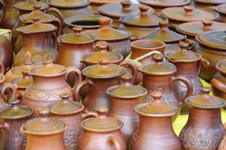 loamy: Plenty of ceramics pots for sale taken closeup. Stock Photo