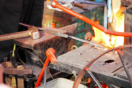 anvil: Blacksmith workshop with anvil and fire taken closeup. Stock Photo