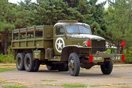 wwii: MARIUPOL, UKRAINE-SEPT 9:GMC CCKW 353 Flatbed truck US Army, historical reenactment of WWII, September 9, 2013 in Mariupol,Ukraine