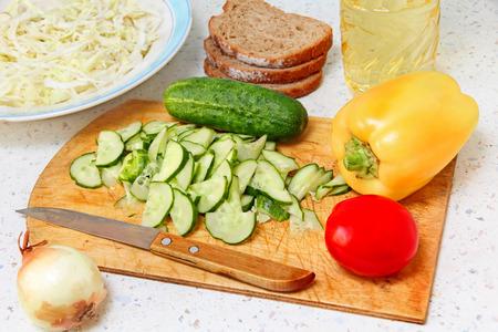 appetizing: Appetizing salad ingredients on kitchen table taken closeup.