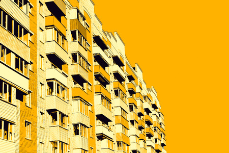 multistory: Modern apartment building on yellow background.Digitally generated image. Stock Photo