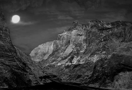toned image: Night mountains landscape with fool moon.Monochrome toned image. Stock Photo
