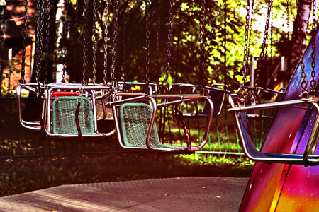vago: Vacant merry-go-round seats.Retro style toned image. Imagens