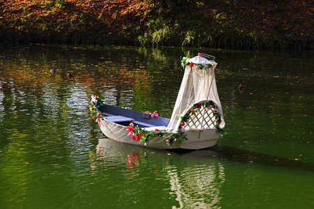 vacant: Vacant wedding boat on a lake. Stock Photo