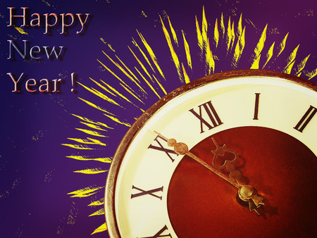 festival moments: Clock face and yellow firework taken closeup on blue background.Eve of new year. Stock Photo