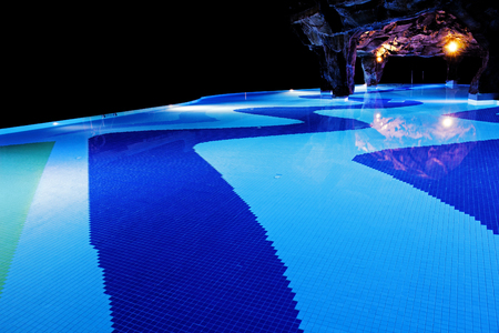 illuminated: Illuminated swimming pool in darkness.
