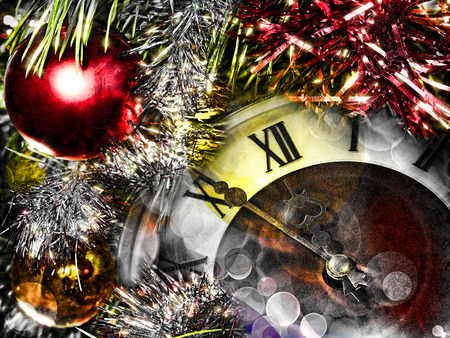 festival moments: Clock face and christmas balls.Eve of new year.Toned image.