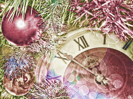 festival moments: Eve of new year.Clock face and christmas balls.Toned image. Stock Photo