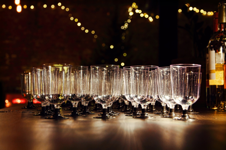 holiday lighting: Empty wineglasses on holiday reception table in night-time lighting.