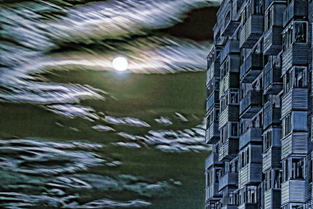 multistory: Multistory house against of dramatic full moon sky.Digitally altered image.