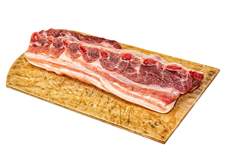 flesh eating animal: Raw pork ribs on wooden cutting board isolated on white background.Toned image. Stock Photo