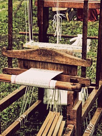weaving: Vintahe weaving loom taken closeup.Toned image. Stock Photo