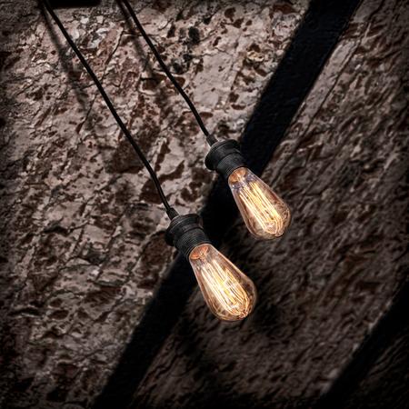 incandescence: Incandescence lamp on brick grunge ceiling taken closeup.