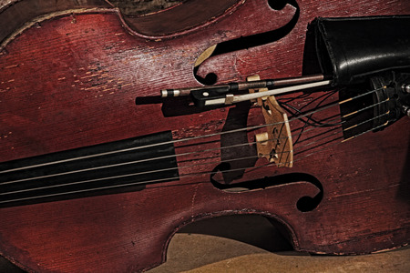 toned image: Old contrabass taken closeup.Retro style toned image.