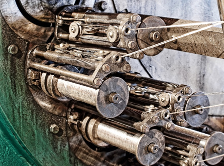 braiding: Detail of braiding machine.Flexible metal hose production.Toned image. Stock Photo