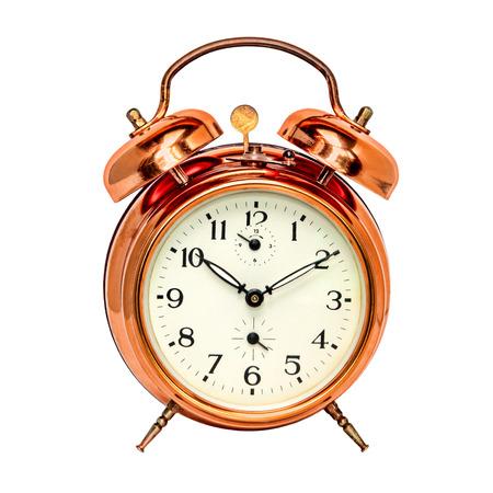 timeless: Vintage bronze alarm clock isolated on white background. Stock Photo