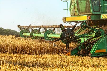 Combine harvester in agriculture field taken closeup.
