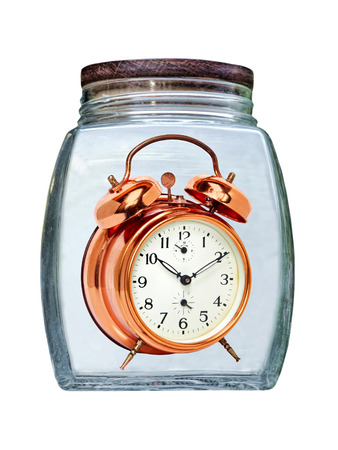 seconds: Canned time concept.Retro Golden Alarm Clock preserved in glass jar isolated on white background.