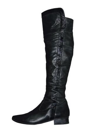 jackboots: Women knee-high leathers boot isolated on white background.