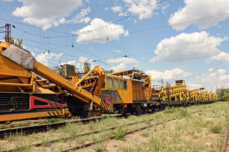 Railway track service car.Crushed stone install construction machine on railway.