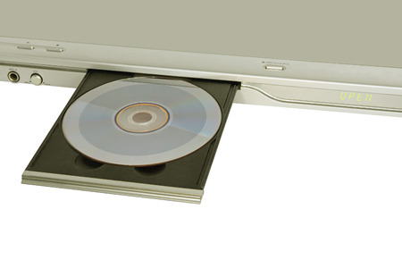 DVDCD player with inserted disc taken closeup on white background.