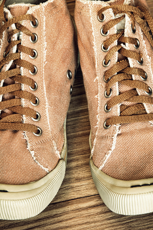 Retro style Gym shoes and Shoelaces taken closeup.Toned image. Stock Photo