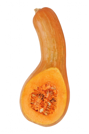 Ripe Sliced Yellow Pumpkin with seeds inside isolated on white background. Stock Photo