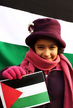 palestinian: A little beautiful girl holding palestinian flag in front on another one