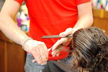 Hands holding scissors cutting hair Stock Photo - 5086612