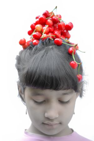 Little girl with cherry on her head Stock Photo - 5100441