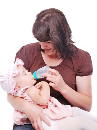 White mother is feeding her little baby Stock Photo - 5141948