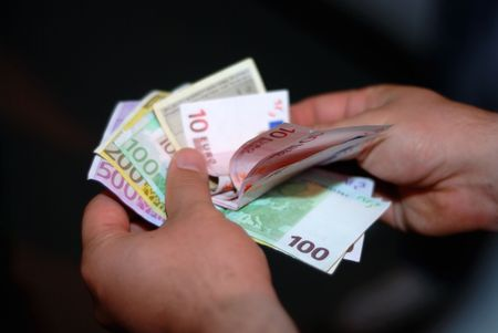 Euro paper money in male hands be accounted