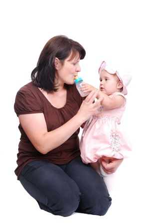 Mom is feeding her baby and vice versa Stock Photo - 5142137