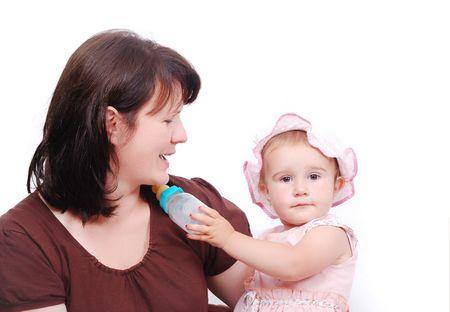 Mom is feeding her baby and vice versa Stock Photo - 5142189