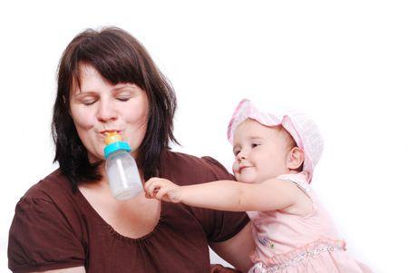 Mom is feeding her baby and vice versa Stock Photo - 5142469