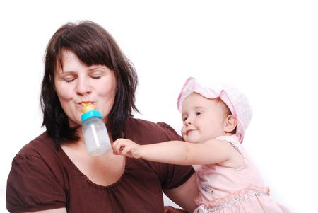 Mom is feeding her baby and vice versa Stock Photo - 5142469