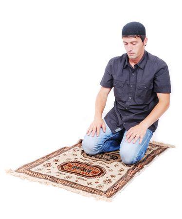 child praying: Muslim man is praying on traditional way Stock Photo